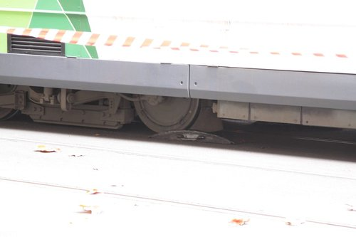 Pulling the tram forwards, the ramps directing the wheels back towards the rails