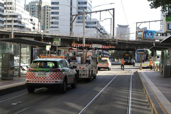 Yarra Trams operations and rolling stock staff attend to the derailment