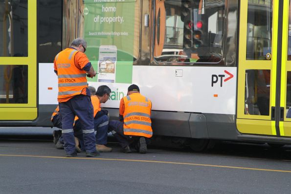 Yarra Trams staff inspect the derailed bogie