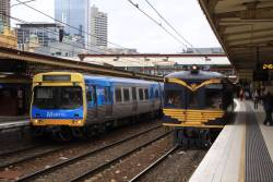 RM58 parallels Comeng 393M out of Flinders Street