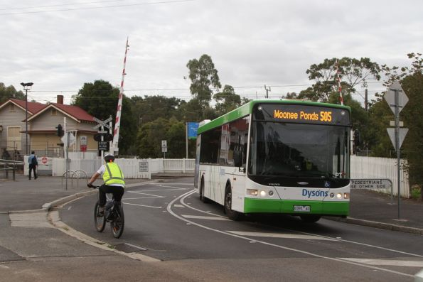 Dysons bus #718 rego 8395AO on a route 505 service passes Royal Park station