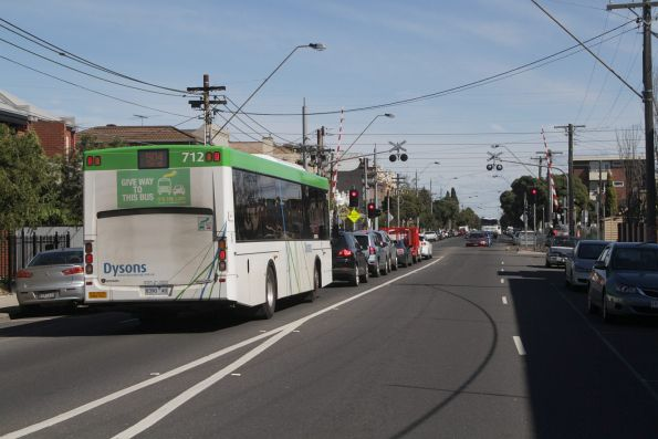 Dysons #712 8390AO on a route 504 service waits for the Upfield line level crossing at Brunswick Road