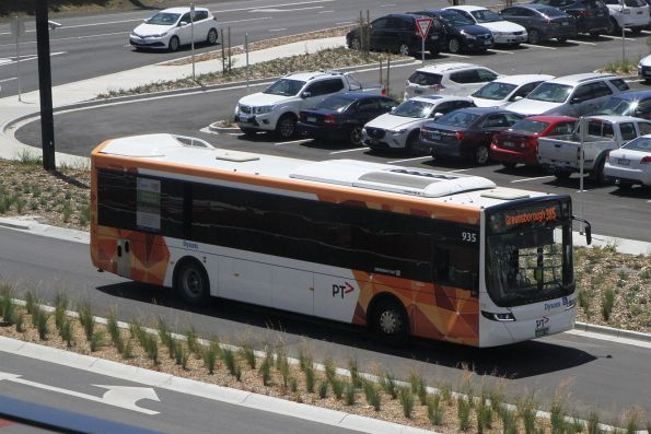 Dysons bus #935 on route 385 arrives at Mernda station