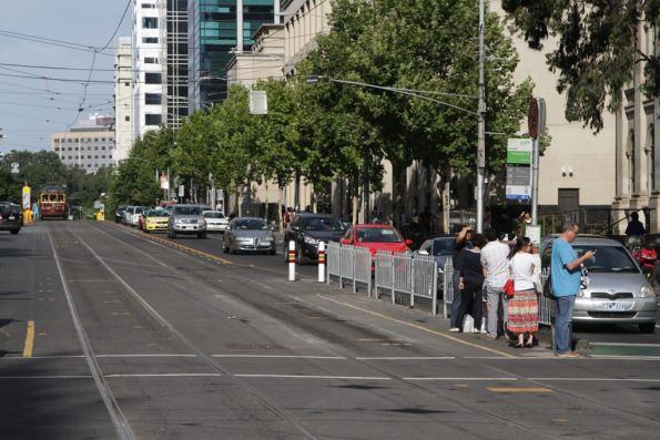 Westbound tram stop at Swanston and La Trobe Street extended to fit E class trams, but with the safety zone prowl removed