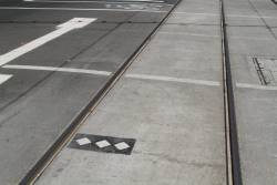 Three diamonds indicate the stopping point for E class trams at a platform stop