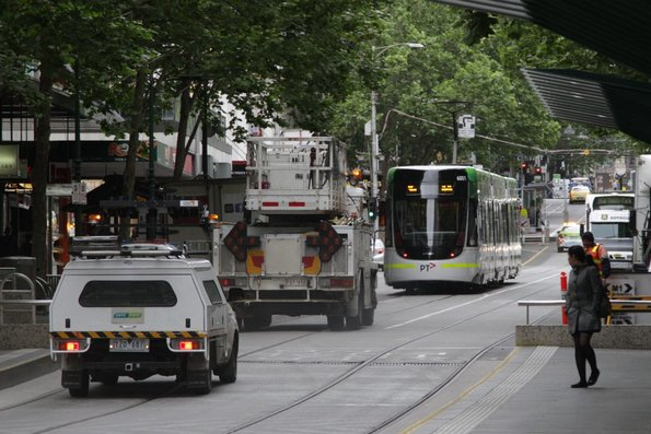 First run with passengers: E.6001 heads east down Bourke Street