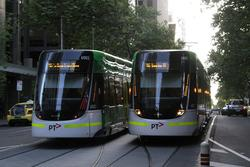 Both running route 96 services: E.6001 passes E.6002 on Bourke Street at Queen