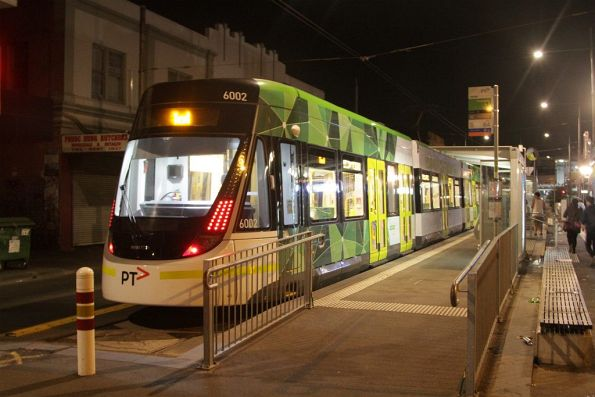 E.6002 on a test run, sitting in the platform stop at Footscray