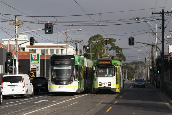 Outbound on Maribyrnong Road, E.6004 passes an inbound Z3.229 on route 57 at Epsom Road, Ascot Vale