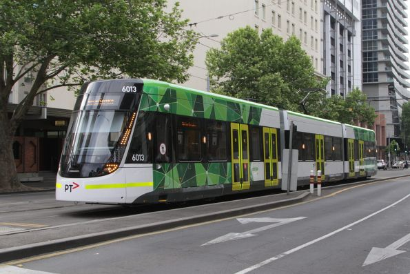 E.6013 on a test run, turning from Spencer into Bourke Street