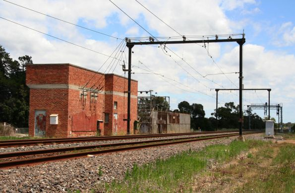 Preserved 1950s red brick traction substation and overhead wiring at Bunyip