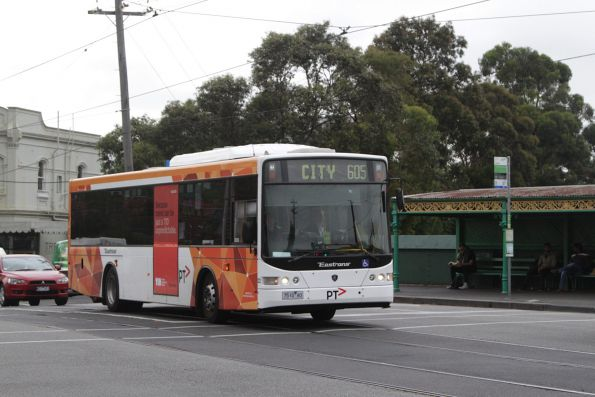 PTV liveried Eastrans bus #122 rego 7510AO on route 605 waits to turn from Malvern into Orrong Road