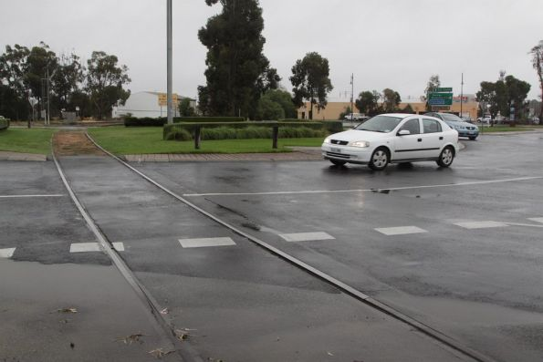 Echuca wharf line crosses a roundabout, looking towards the station