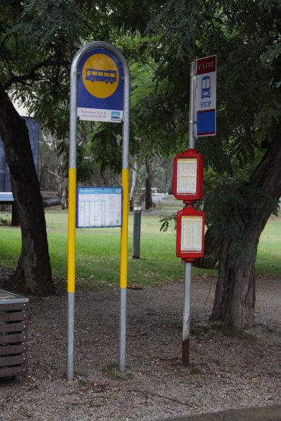 CountryLink and V/Line bus stop signs outside the visitor information centre in Echuca
