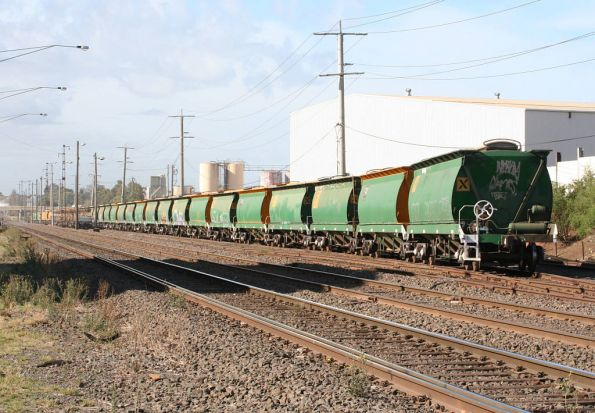 AHGX broad gauge grain hoppers used by El Zorro, stabled at Brooklyn along with some rail flats