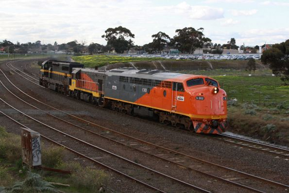 S302 leads the lashup through Albion, bound for servicing at South Dynon