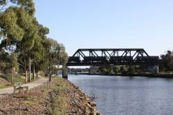 WGSY grain wagons roll over the Maribyrnong River bridge bound for North Dynon