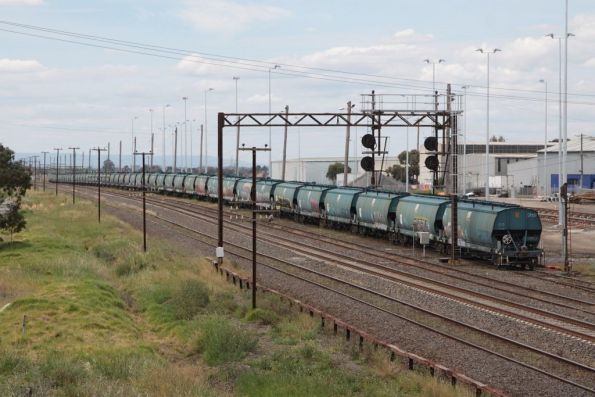 Stabled WGBY grain hoppers in number 3 road at McIntyre Loop