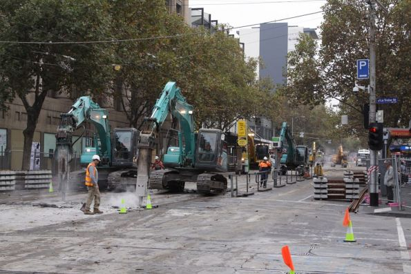 Three pairs of breakers attacking the concrete north of La Trobe Street