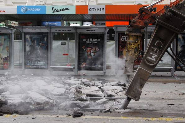 Pair of concrete breakers at work at the La Trobe Street tram stop