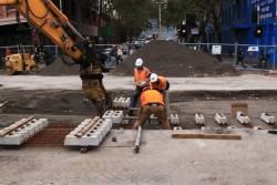 Placing sleepers into position at Elizabeth and Therry Streets