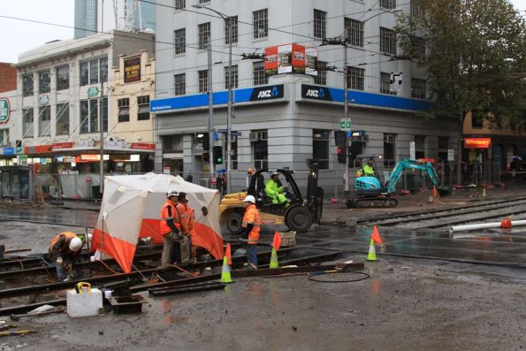 Welding crew working on the H crossing at Elizabeth and La Trobe Streets