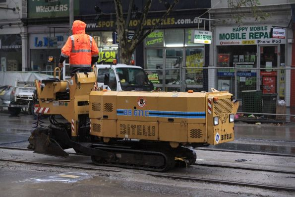 Mini asphalt paving machine between jobs