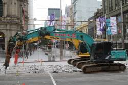 Breaking up concrete at the corner of Bourke and Elizabeth Streets