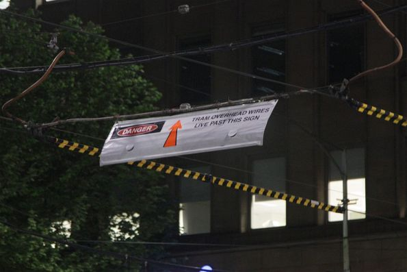 'Tram overhead live past this sign' notice on Elizabeth Street at Collins Street