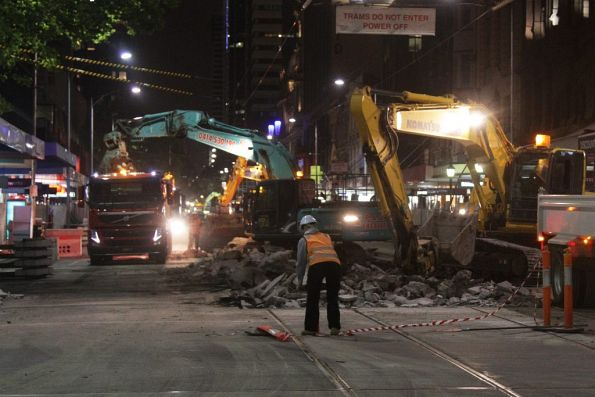 Excavators removing rubble from Elizabeth Street at Collins Street