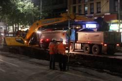 Excavators removing rubble from Elizabeth Street at Little Collins Street