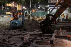 Excavators removing the former 'H' crossing at Bourke and Elizabeth Streets