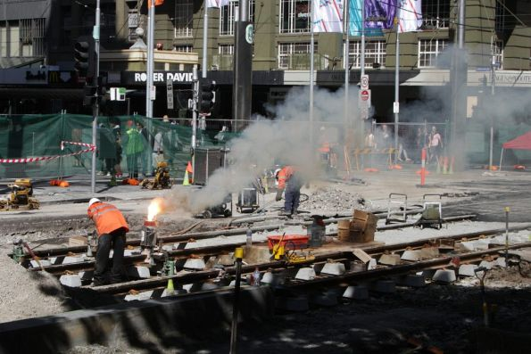 Welding rails at the corner of Elizabeth and Bourke