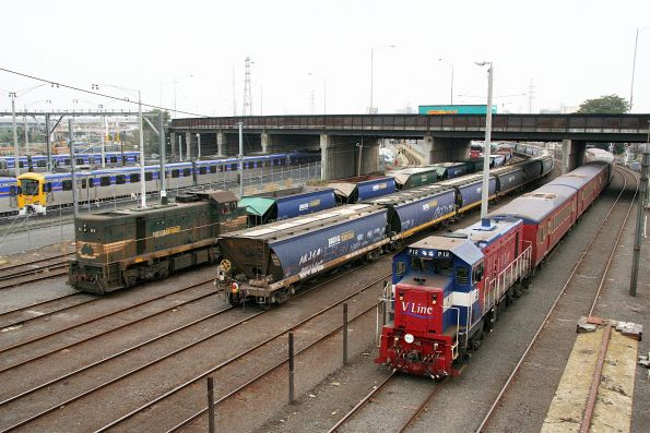 P12 passes the waiting transfer and the Kensington grain at Melbourne Yard