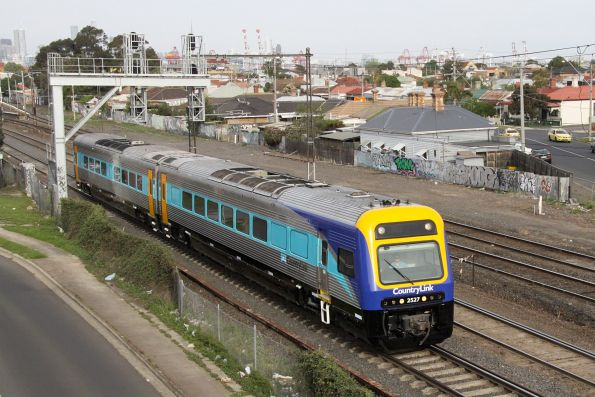 Refurbished Endeavour car EC2527 leads EB2516 through Middle Footscray bound for New South Wales