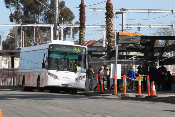 Nuline Charter bus #82 BS04EZ on a Craigieburn line rail replacement service at Essendon station