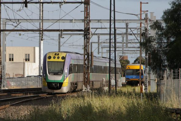VLocity 3VL19 failed at Albion, with a suburban train waiting close behind