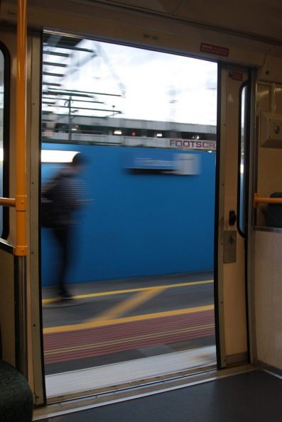 Departing Footscray station with the train doors open