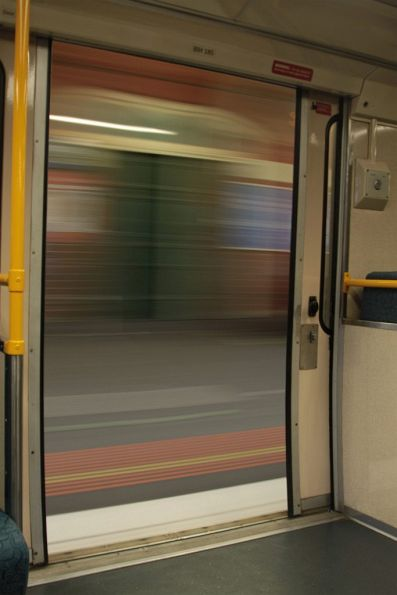 Picking up speed with the train doors open on departure from Footscray