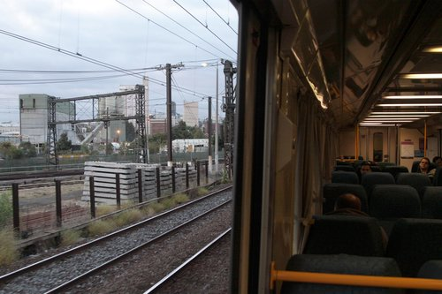 Looking out the open door outside North Melbourne station