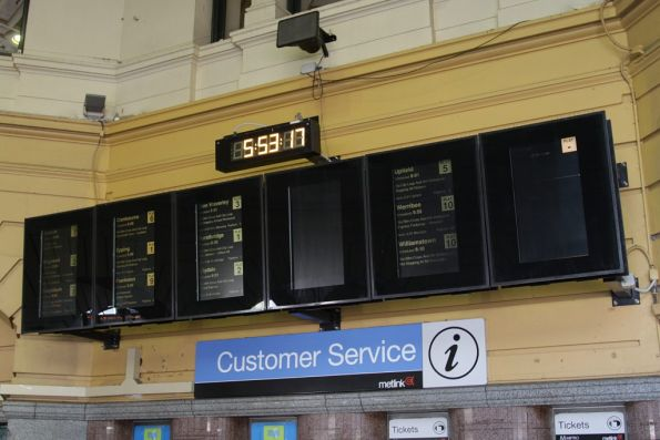 Next train displays at the main entrance to Flinders Street Station: the middle screen is a dud