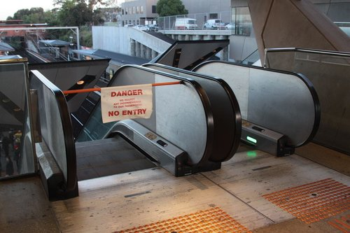 Escalator out of use at North Melbourne station in the leadup to morning peak