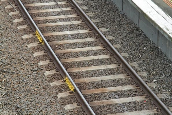 Pair of temporary fishplates reinforcing a rail at Watsonia station