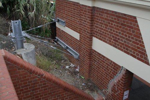 Steel girder and rod reinforces the cracked station building at Hawksburn platform 1