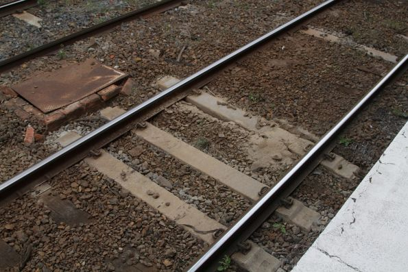 Mud holes in the tracks at Hawksburn station