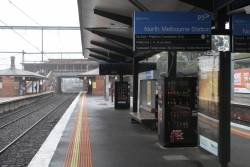 Wet day at North Melbourne, and the modern verandas do nothing to shelter passengers