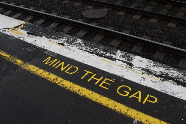 'Mind the Gap' notice at South Kensington, in front of a rotting timber platform edge