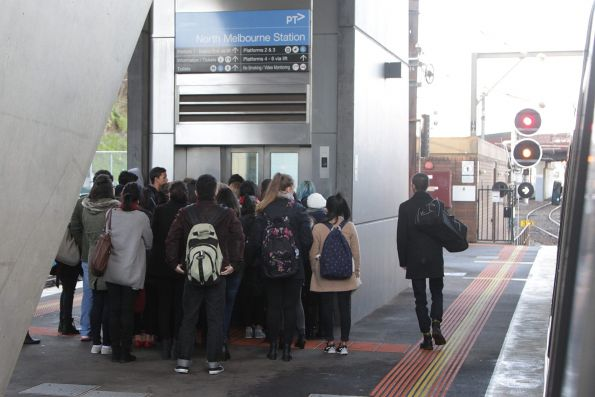 Passengers queue for the lift at North Melbourne platform 2 and 3 due to the escalators breaking down yet again