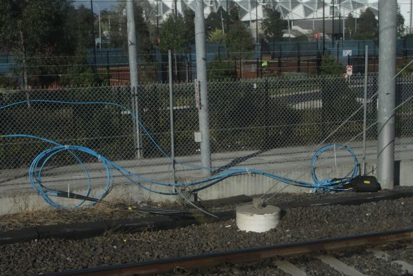 VicTrack fibre optic cables cabletied to a fence at Richmond station
