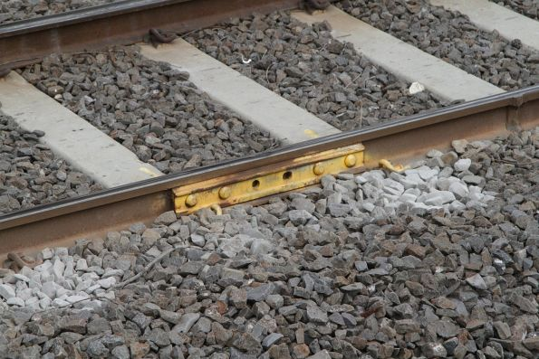 Temporary fishplate bolted to a broken rail at Spotswood